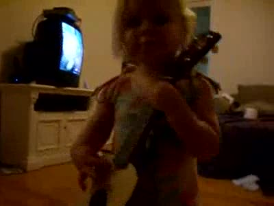Little Isabella Plays Guitar